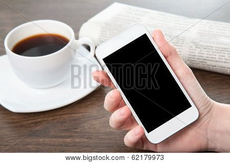 Businesswoman Hand Holding A Phone In The Office