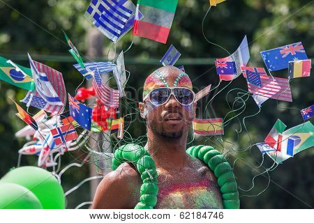 TEL AVIV, ISRAEL - JUNE 11, 2010: Participant wear sunglasses and bizarre costume with different flags during traditional annual Gay Pride parade and Week of Proud celebrations in Tel Aviv, Israel.