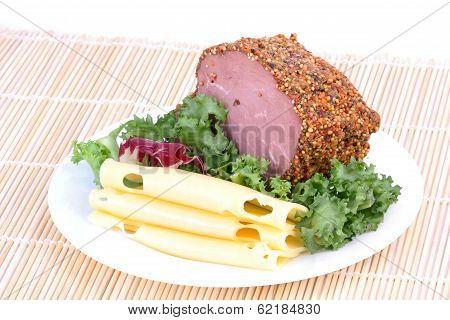 Bloated Beef, Cheese And Salad Leaf On Plate On Mat