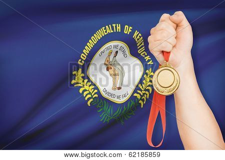 Medal In Hand With Flag On Background - Commonwealth Of Kentucky. Part Of A Series.