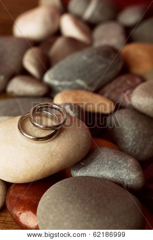 Wedding rings on rocks close-up