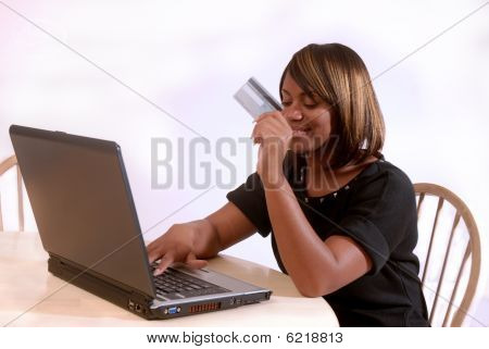 African-american Woman about to make an online purchase