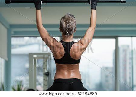 Female Athlete Doing Pull Ups