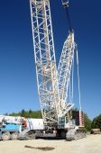 picture of oversize load  - Huge crane with blue sky in the background - JPG