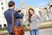 pic of two women taking cell phone  - Tourists taking picture on travel in Barcelona - JPG
