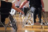 picture of paralympics  - Wheelchair users in a basketball match in a gym