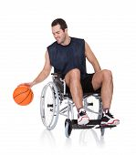 picture of paralympics  - Man in wheelchair playing basketball - JPG