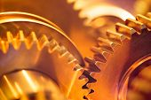 stock photo of gold tooth  - golden gear wheels - JPG