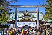 TOKYO, JAPAN - MARCH 23, 2014: Tourists crowd Yasukuni Shrine. The shrine is one of the most controv
