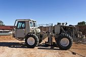 stock photo of vibrator  - Mobile seismic buggy equipped with a vibrator at rig site for a seismic survey - JPG