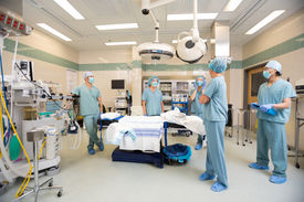 stock photo of operation theater  - Medical team having a discussion in operation room - JPG
