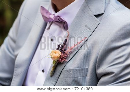 A Detail Photo Of A Grooms Wedding Boutonniere