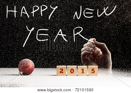 Man Writing A 2015 Happy New Year Greeting