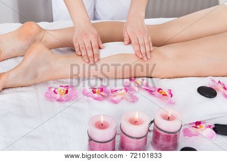 Beautician Waxing Woman's Leg