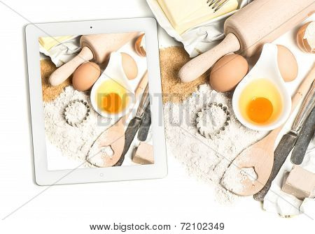 Notebook Tablet Pc And Baking Ingredients. Taking Food Photos
