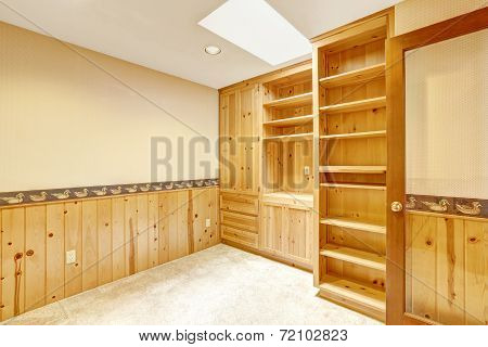 Bright Office Room With Wooden Cabinets And Wood Wall Trim