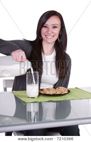 Beautiful Girl Pouring Milk To Her Glass