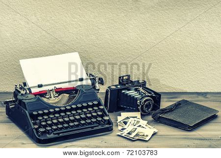 Antique Typewriter And Vintage Photo Camera