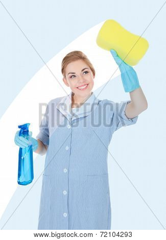 Happy Maid Holding Cleaning Liquid And Sponge