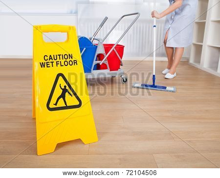 Female Sweeper Cleaning Floor