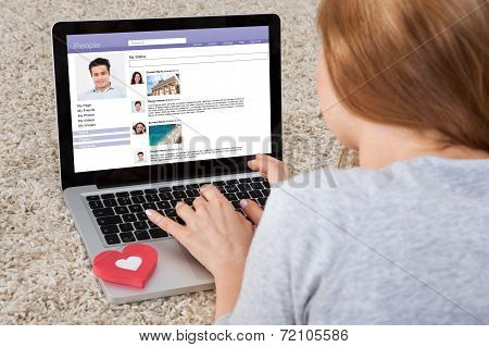 Woman Chatting On Laptop
