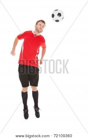Soccer Player Jumping Over White Background