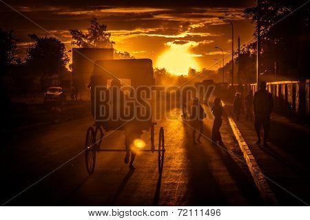Riding rickshaw at sunset