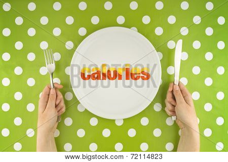 Hands At The Table With Calories On Plate