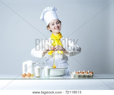 Cook Breaking Egg