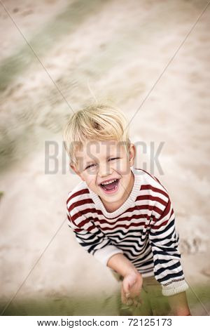 happy laughing child on the beach