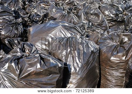 Pile Of Black Garbage Bags With Tons Of Trash, Horizontal