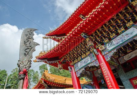 Chinese Temple With A Chinese Weapon Called  Green Dragon Crescent Blade Or Guan Dao