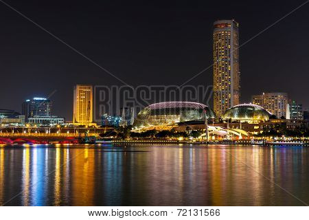 SINGAPORE-SEP 04: The downtown and Esplanade of Singapore in night time on Sep. 04, 2014. The scenic view around the Marina bay and Esplanade building.