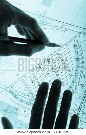 Surveyor's Plan And Hands With A Pencil