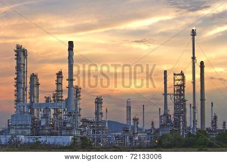 Oil Refinery At Twilight Sky.