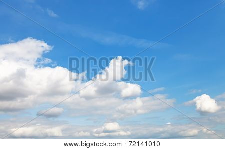 White Cumulus Clouds In Blue Autumn Sky
