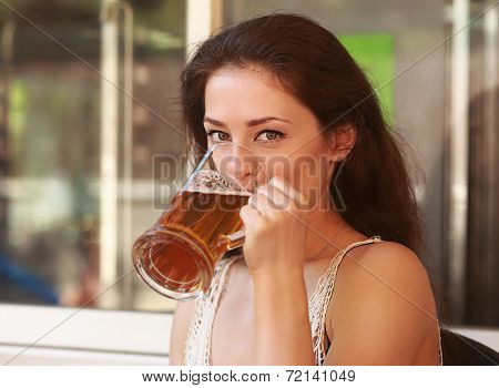 Beautiful Happy Woman Drinking Lager Beer. Closeup Portrait