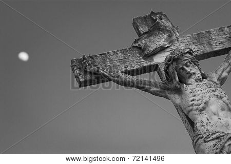 Crucifixion Of Jesus Christ On A Background Of The Sky And The Moon.
