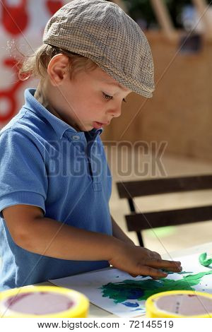 Boy Draws With Plasticine