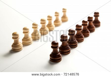 Chess Pieces Lined Up In A Row On A White