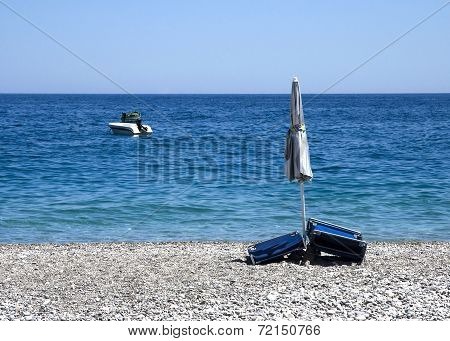 still-life with beach umbrella and a boat