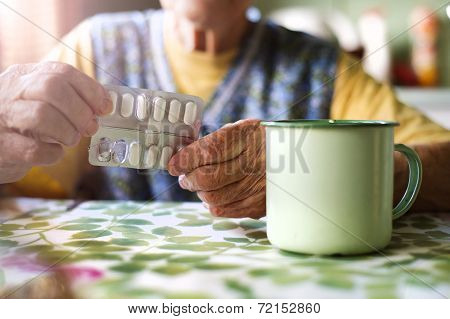 Old woman with pills
