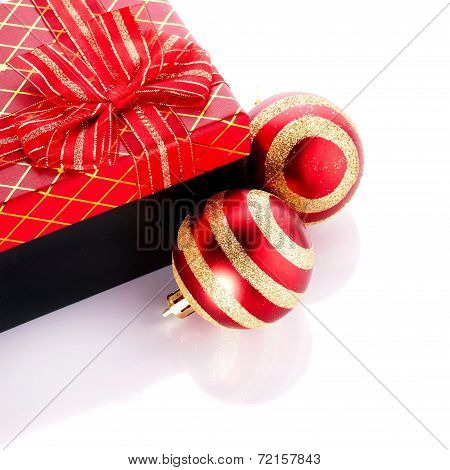 New Year's Striped Red Balls And Gift.