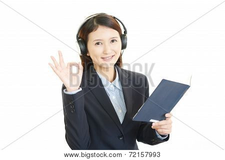 Call center operator with ok hand sign
