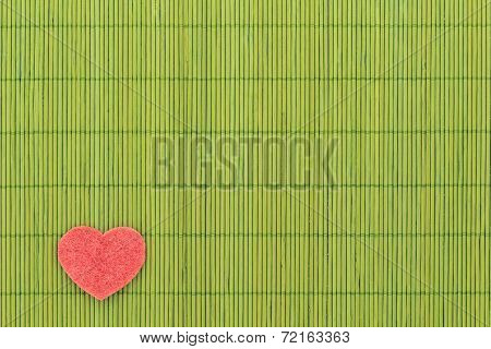 Heart And Love Symbol Against Bamboo Sticks