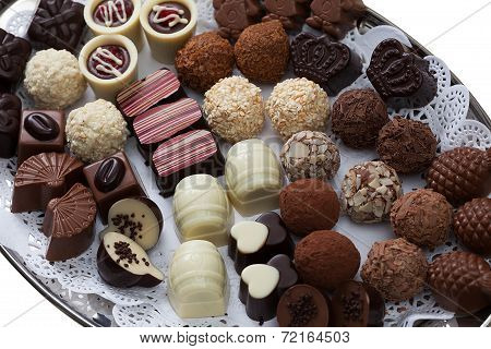 Appetizing chocolate candies assortment, close-up