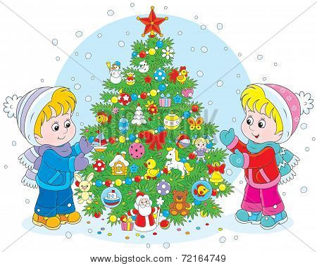 Children and Christmas tree