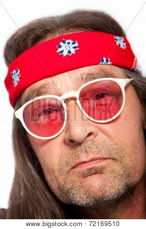 Man Wearing Headband And Rose Colored Glasses