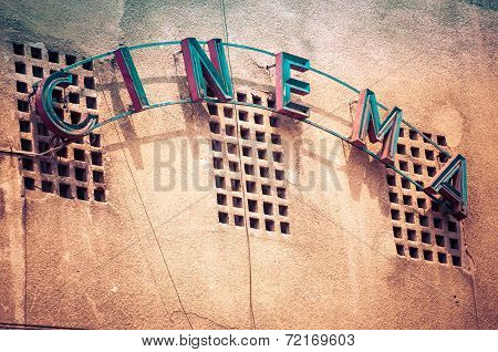 Vintage Facade Of Old Cinema In Bucharest Romania, With Cinema Word Written