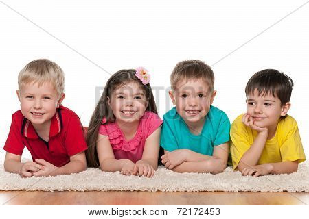 Four Happy Children On The White Carpet